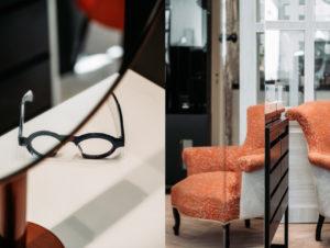 details interieur boutique lunettes posées et siège rouge