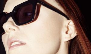 Lunetier Magnuson visage jeune fille et lunettes de solail