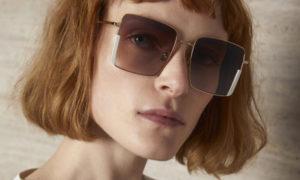 Jeune femme avec des lunettes de soleil kaleos