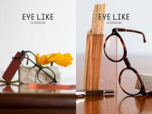 Présentation de deux montures de lunette de la collection Eye Like, l'une présentées sur un bureau décoré d'une fleur jaune large, l'autre posée de biais sur un support de verre